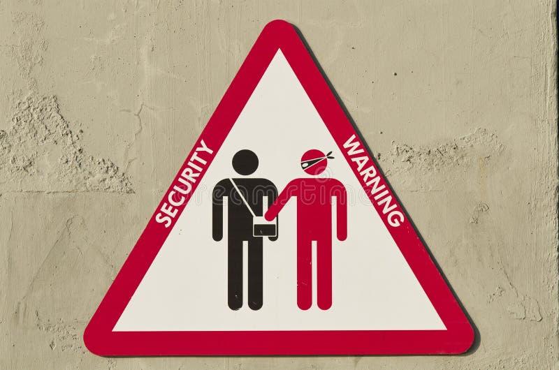 三角标志警告关于被抢夺的风险 图库摄影