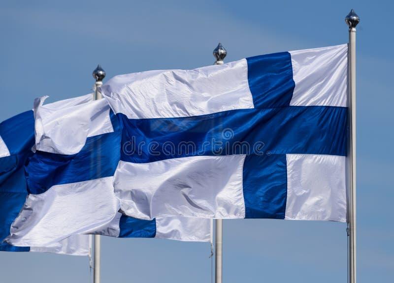 三面芬兰旗子飞行 免版税库存照片