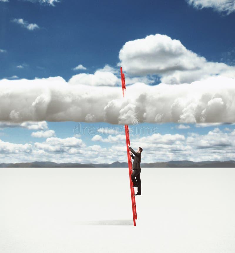 上升在云彩的人 免版税库存照片