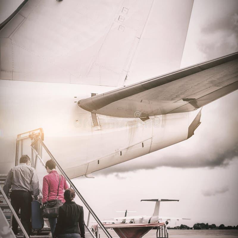 上在飞机的人们 库存图片