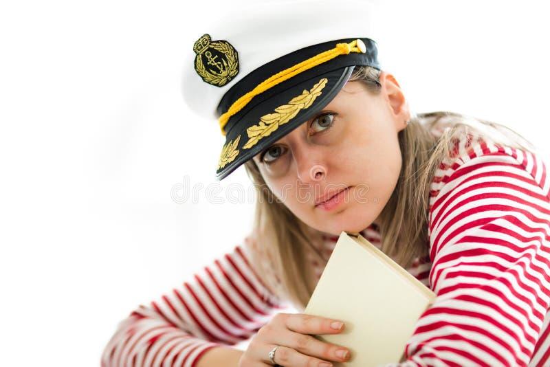 上尉盖帽藏品书的年轻女人水手 库存照片