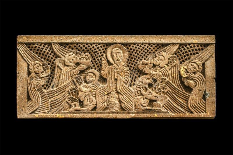 上帝和天使的浮雕象在遮阳,被雕刻石头亚美尼亚字母的第二个字母,在St教会里  库存图片