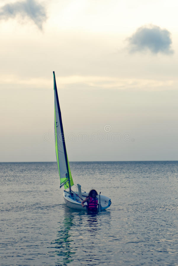 上激光风船的女孩 图库摄影