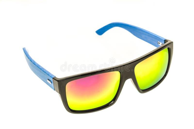 上色儿童太阳镜、被隔绝的太阳树荫或者眼镜  免版税库存照片