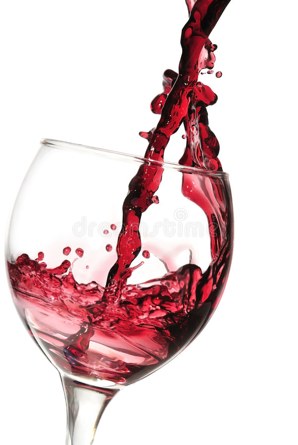 下来倾吐的红葡萄酒 库存照片