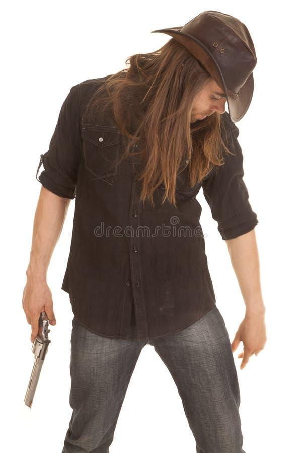 下来牛仔长的头发举行手枪神色 免版税图库摄影