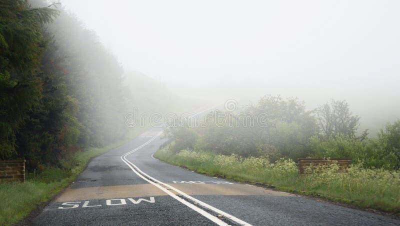 下来驱动雾路的中断危险慢 库存照片
