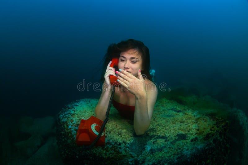 水下的电话 免版税库存照片