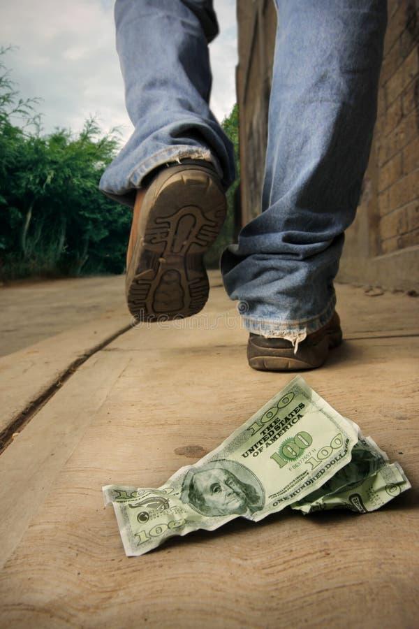 下落不幸人的货币 库存照片