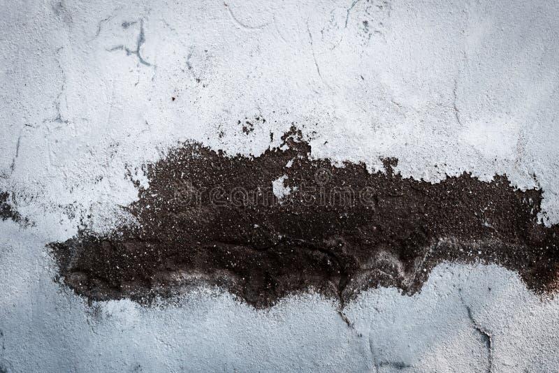 下落的膏药墙壁 免版税库存照片