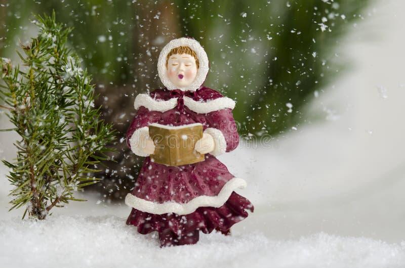 下雪和唱歌 免版税图库摄影