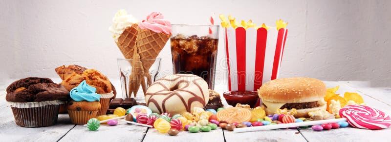 不健康的产品 图、皮肤、心脏和牙的食物坏 免版税库存照片