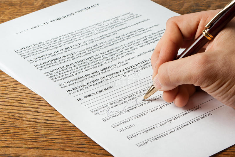 不动产合同签字 图库摄影