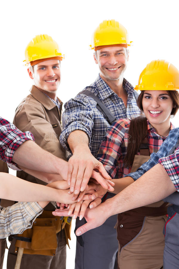 不同的小组堆积手的建筑工人 免版税库存照片
