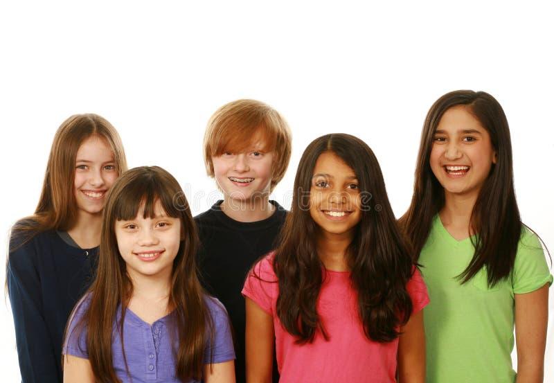 不同的小组男孩和女孩 库存照片