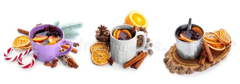 不同的杯子用在白色背景的热的加香料的热葡萄酒 图库摄影