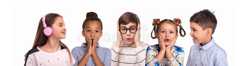 不同的种族微笑的schoolchilds演播室画象的拼贴画  库存照片