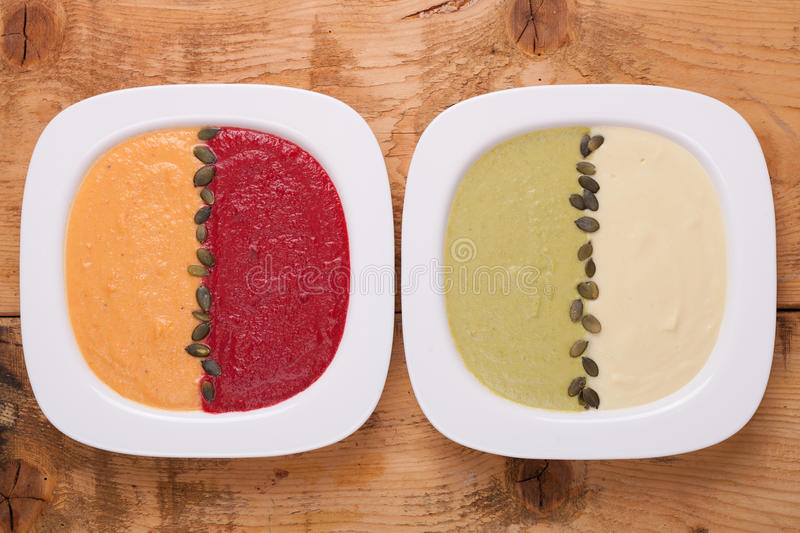 不同的色的纯汁浓汤汤 库存照片