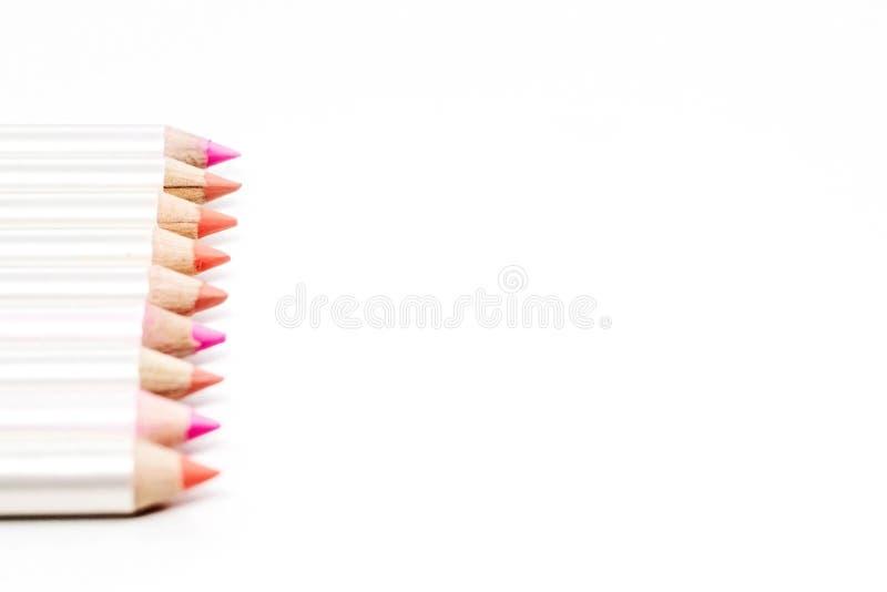 不同的颜色的嘴唇的铅笔在白色的 免版税图库摄影