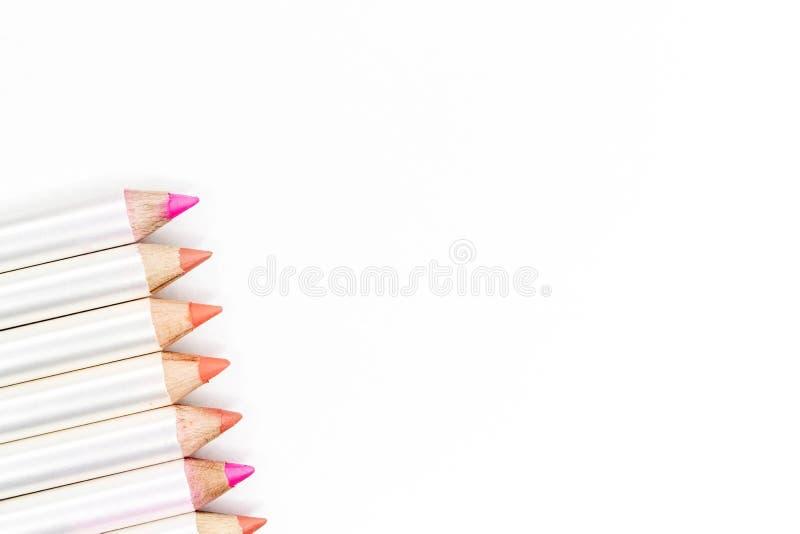 不同的颜色的嘴唇的铅笔在白色的 图库摄影