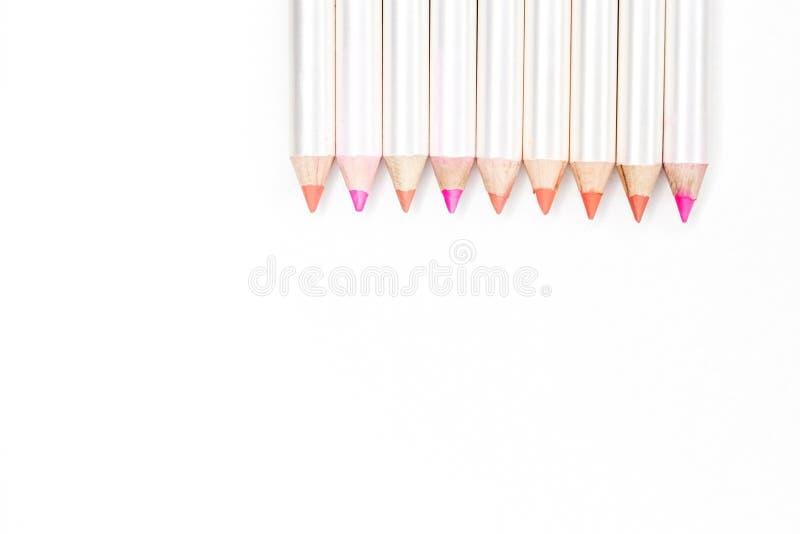 不同的颜色的嘴唇的铅笔在白色的 库存图片