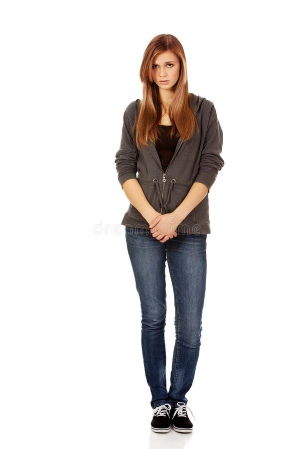 不快乐和体贴的少年妇女 免版税库存图片