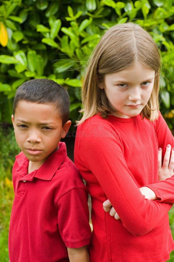 不快乐的男孩和女孩 免版税库存照片