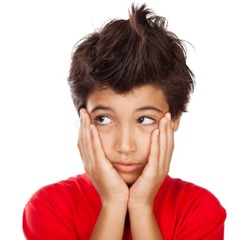 不快乐的男孩画象 免版税库存照片