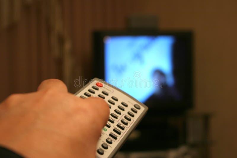 不断换电视频道 免版税库存图片