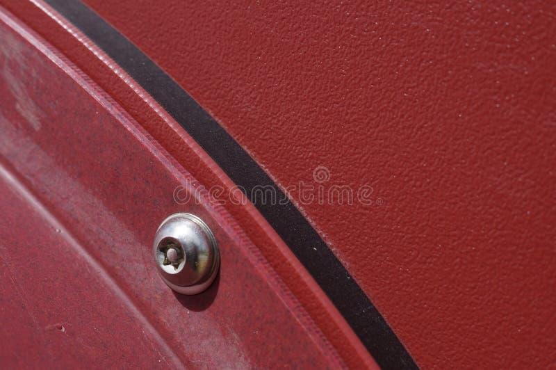 不锈的硬件和红色结构 库存照片