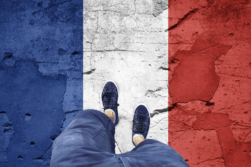 与一个人的损坏的法国旗子 库存图片