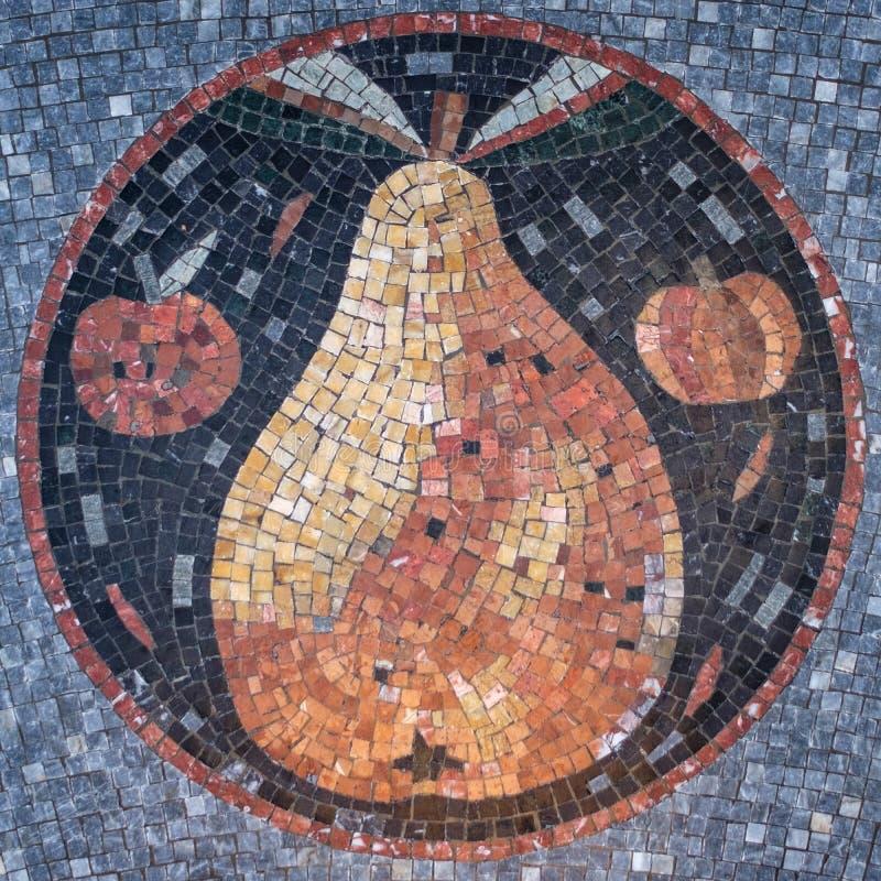 与一个梨设计的拼花地板在中心 库存照片