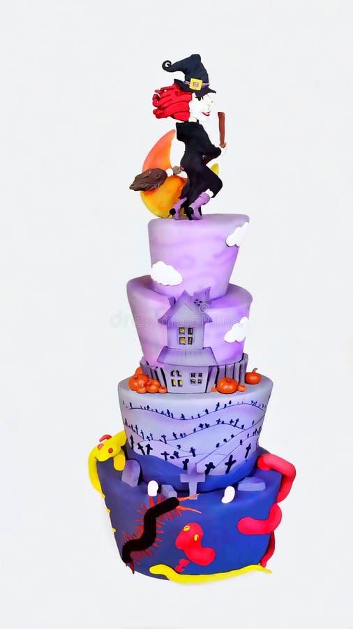 与一个滑稽的巫婆的五颜六色的万圣夜蛋糕 图库摄影