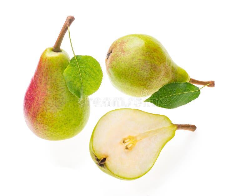 与一个的新鲜的成熟绿色和红色梨删去了入一半juic 免版税库存图片