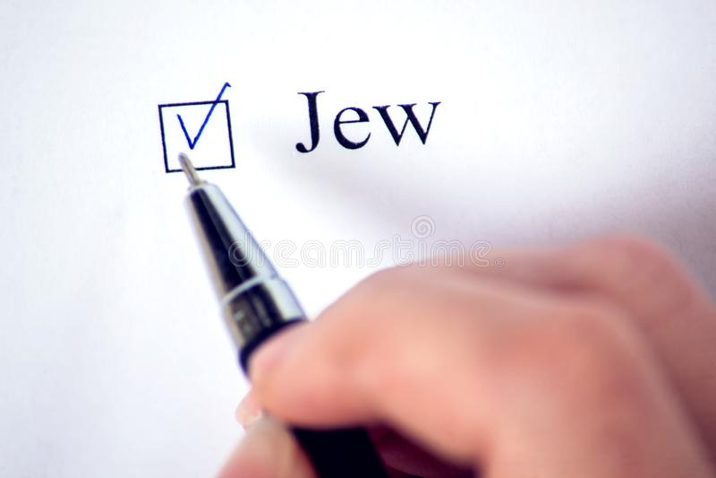 与一个词犹太人的清单白皮书的 复选框和宗教概念 免版税库存照片
