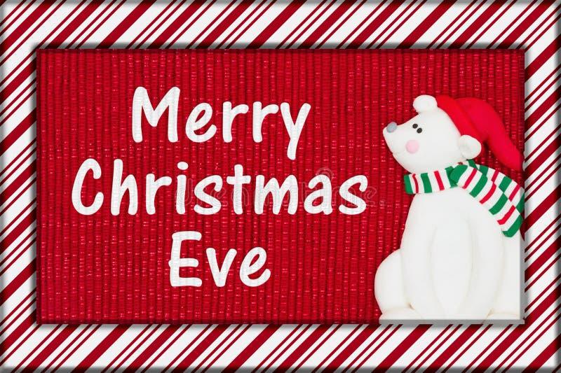 与一头北极熊的圣诞快乐伊芙问候 免版税库存图片