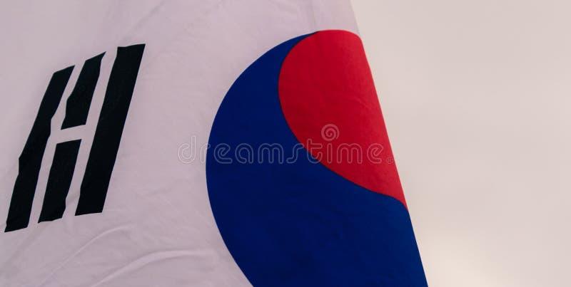与一部分的韩国旗子的中心红色和蓝色标志 库存照片
