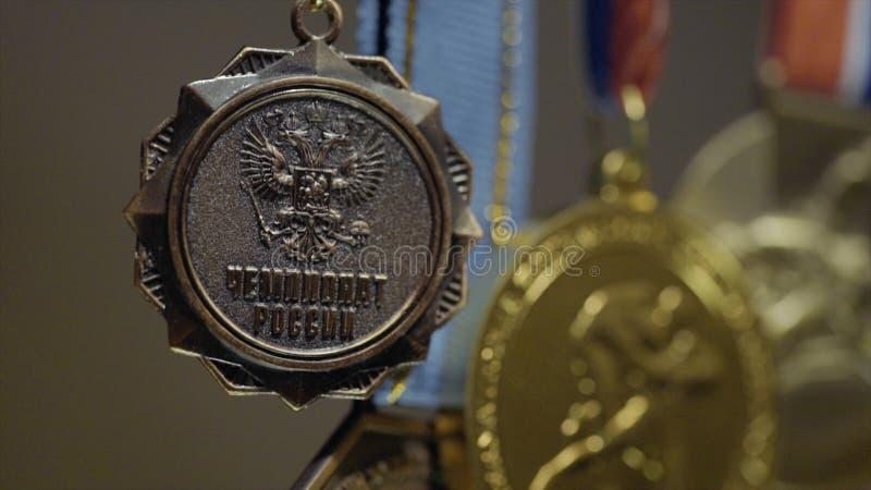 与三色丝带特写镜头的许多金牌 第一个地方的奖牌在柔道的竞争中 a的许多奖牌 图库摄影