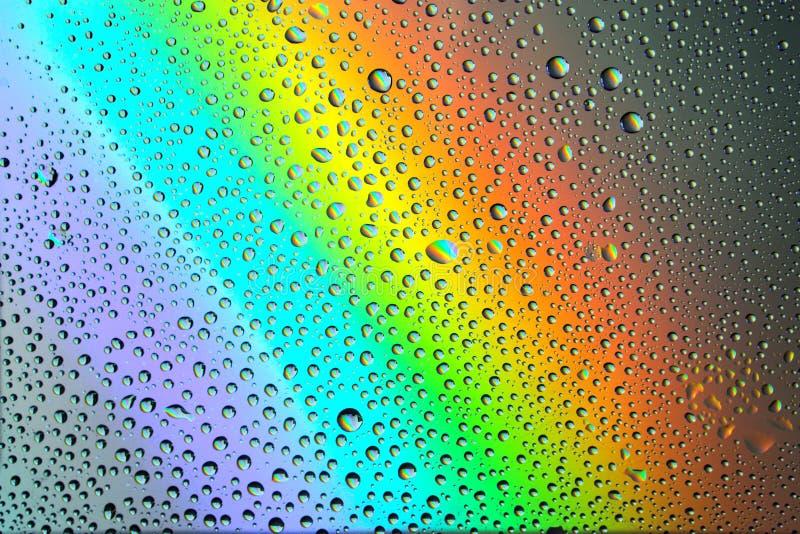 与下落的彩虹背景 库存照片