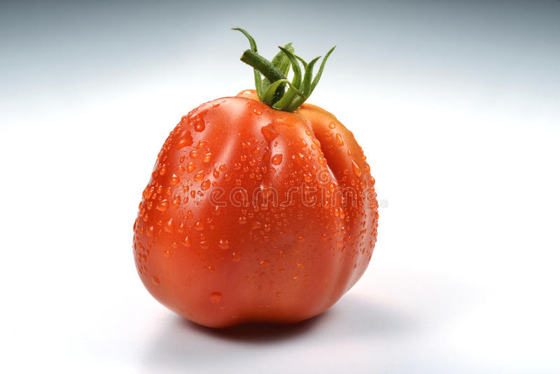 与下落3的牛排蕃茄 免版税库存图片