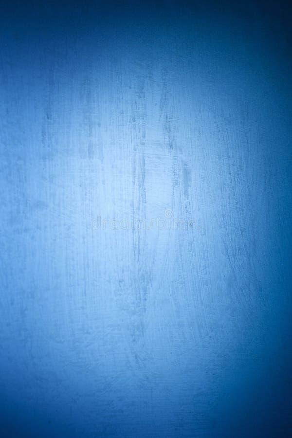 与与油漆有选择性的斑点的五颜六色的抽象光滑的纹理  与小插图和明亮的中心的蓝色背景 库存图片