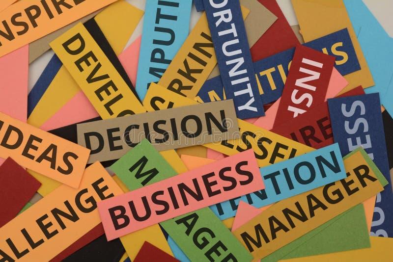 与与生意相关的词拼贴画的五颜六色的纸牌 库存照片