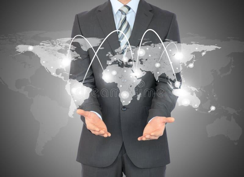 与世界地图的商人在手上 皇族释放例证