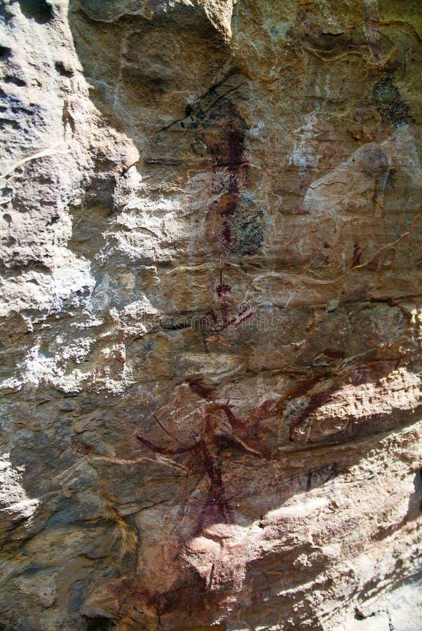 与丛林居民圣人岩石绘画的亦称砂岩在Malealea附近的Makhaleng谷,马费滕,莱索托 免版税库存照片