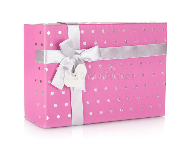 与丝带和弓的桃红色礼物盒 库存照片