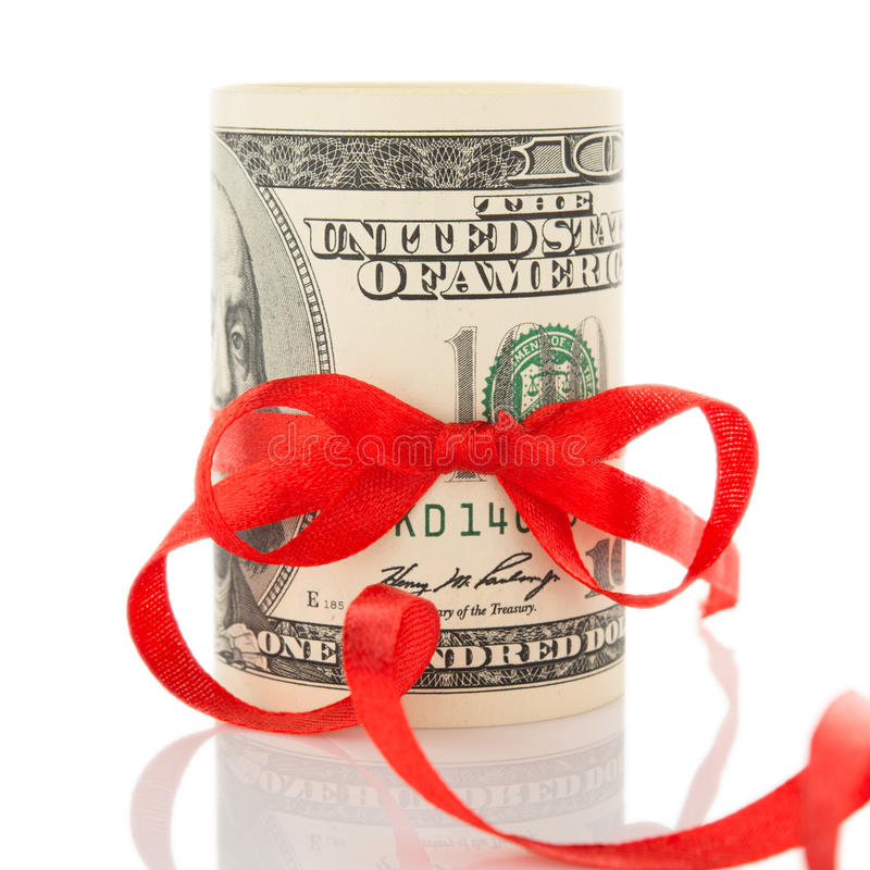 与丝带和红色弓的货币 库存图片