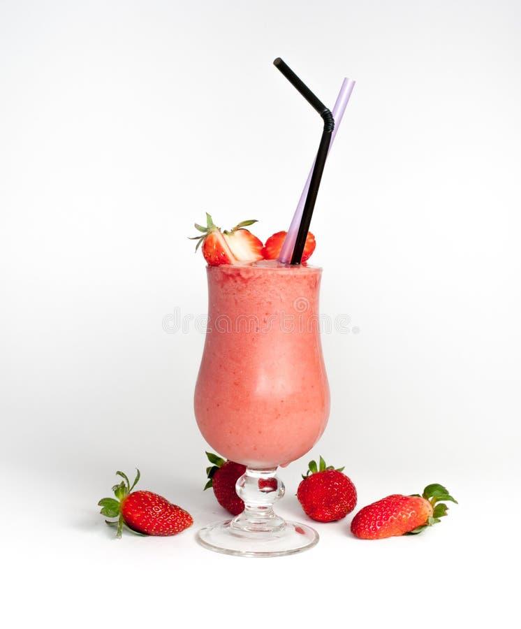 与两秸杆的草莓圆滑的人 图库摄影