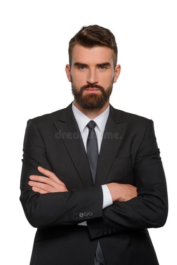 与严肃的面孔的确信的商人 免版税库存图片