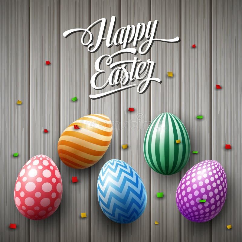 与五彩纸屑的愉快的复活节彩蛋在木棕色背景 皇族释放例证