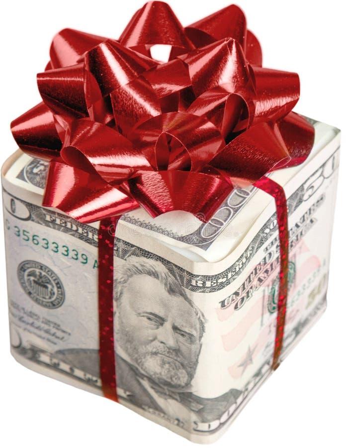 与以美元包裹的红色弓的圣诞节礼物 免版税库存图片
